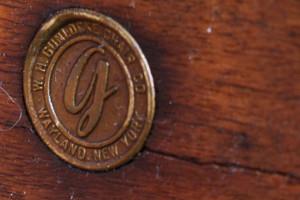 Gunlocke chair gold stamp